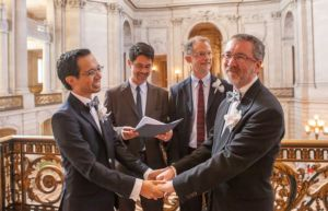 Jeff Tabaco and Thom Watson marry at SF City Hall, officiated by Stuart Gaffney and John Lewis