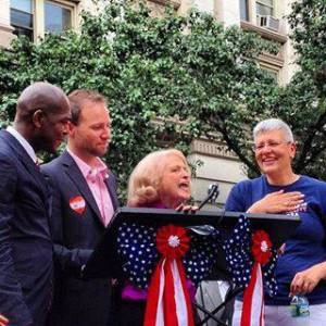 Edie Windsor on June 26, 2013 speaking at a celebration rally in front of Stonewall in between Brian Silva and Cathy Marino-Thomas of Marriage Equality USA